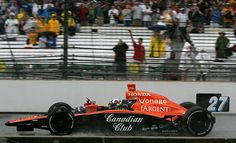 2007: Dario Franchitti. Another rain-shortened race as the photo shows, called after 166/200 laps.