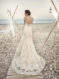 New from the Eddy K. 2017 Dreams collection is Aires, a wedding dress that is pure romanticism. The gorgeous lace detailing all over the dress, its illusion back and its alluring v-neckline make it a