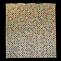 """All pieced and made by hand with reproduction fabrics of the 1930's, Thuy Nguyen is a well known quilter for her detail. The """"Cathedral Window"""" is 88"""" x 94"""", so would fit nicely on a queen bed, but would also make a spectacular wall piece."""