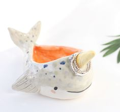 A narwhal ring dish. The most logical place for your jewelry.