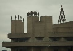 Antony Gormley sculptures on the National Theatre