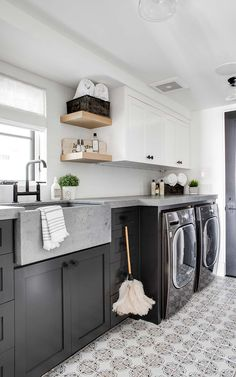 Concrete countertops a dark and moody washer/dryer if laundry must exist as a chore its only fair the laundry room reflect our attitude toward it! Builder: Patterson Custom Homes Interior: MD Curated Design Lens: Chad Mellon Photographer White Laundry Rooms, Farmhouse Laundry Room, Laundry Room With Sink, Laundry Sinks, Laundry Rack, Laundry Room Cabinets, Laundry Room Floors, Laundry Room Countertop, Basement Laundry