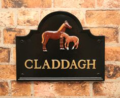 Claddagh - SST15 cast metal sign in black with gold letters and mare and foal motif.  Sent to Republic of Ireland.   www.rockartisansigns.co.uk