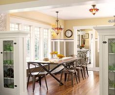 This detail-rich dining room features beautiful built-ins with leaded-glass.