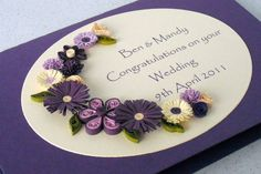 Wedding congratulations card with quilled flowers, personalized with names and date.    A beautiful quilled card with quilling flowers in
