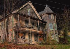 Broken Promises-abandoned three story, dbl porch, turret, modest... entr