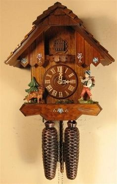 """Cuckoo Clock with Happy Wanderer and Dog, Model #8205     Chalet cuckoo clock with """"Happy Wanderer"""" and dog. German Regula, 8 day movement with gong and cuckoo on the hour and half-hour. Hand spliced roof shingles. Antique stain, hand-painted flowers and night shut-off and 2 year warranty. Made by Rombach & Haas."""