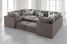 Dr. Pitt Slipcovered Sectional  If I had a finished basement or a room large enough to accommodate this, I think my daughter would love it for slumber parties. There are endless possibilities as to how you can configure it. more
