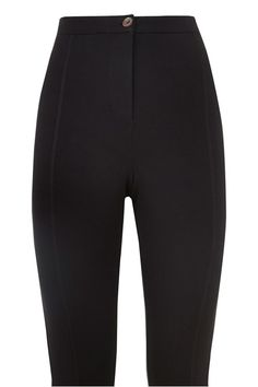 Black stretch trouser in 95% Fairtrade certified organic cotton, 5% elastane. Vertical stitch detail and ankle zip, with shell button and front fly zip fastening. Length 75cm.