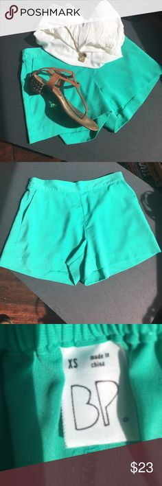 """BP Brass Plum shorts bright green XS Bright green BP ((Nordstrom brand)  shorts.  Size XS.  Pockets on both sides in front.  Elastic waist for easy flattering fit.  Wide leg opening makes legs look thinner!  Waist is 13"""" but remember there's elastic in back, inseam is 3"""", leg opening is 10"""".  Great condition BP Brass Plum Shorts"""