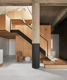 Vladimir Radutny Architects transformed a loft located in a century-old building on Chicago's Michigan Avenue into a spacious home for two, with wood and steel volumes slotted within an exposed concrete structure. Michigan Loft is winner of Dezeen Awards' New Staircase, Staircase Design, Staircases, Chicago Lofts, Chicago Usa, Chicago Illinois, Casa Cook, Interior Design Minimalist, Minimalist Room