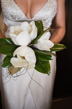 Magnolia Grandiflora bouquet... maybe we could be extra sentimental and get them from court's tree :)?