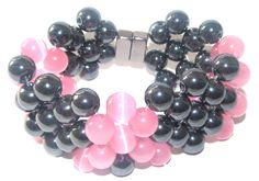 PRMB-202      8 mm Round Magnetic Hematite and Pink Quartz Wire Bracelet with magnetic clasps.  Sizes 6-10     Rose Quartz is a Stone of Love. It heals emotional wounds and pain with its gentle calming salve.    Magnetic Hematite is a Stone for the mind. It brings mental organization and is very ...