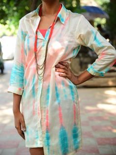This summer, beat the heat with our White Chanderi Tye and Dye shirt dress by Ekta & Sonal. Designed from extremely soft fabric, the ultra-comfy shirt dress is sure to help you cope with scorching heat. You can style this trendy shirt dress with a stylish sling bag and get a sporty look.