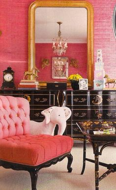 .Never has shocking pink - grasscloth wallpaper & tufted chair - looked so sophisticated with black accents ~