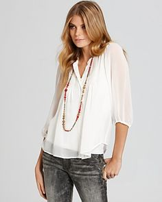 White blouse. Washed jeans. Minimal jewelry. One of my favorite looks