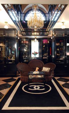 Ridiculous Master closet that puts all master closets, and most homes to shame. The staircase is an exact replica of the original Chanel boutique in Paris.
