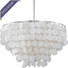 Highlighted by cascades of shimmering shell-style discs, this elegant pendant casts a warm glow over your dining table or living room seating group....