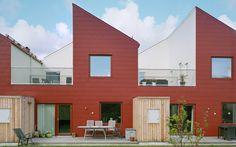 Äppelträdgården Exterior Row houses Facade Balcony Terrace Red White Privacy