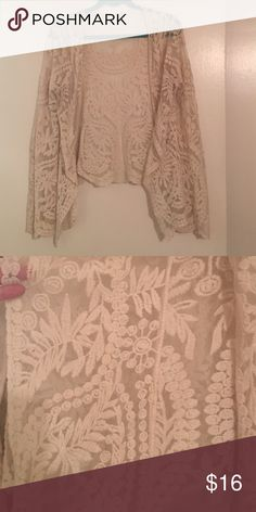 Beautiful cream lace kimono It is sooooo cute! There's no tag! I've worn it twice. I bought it another size that listed this as OSFA but I think it fits a med-lg best. Wouldn't work for a XL and might be too baggy for a small. No flaws Tops Blouses