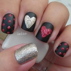 Matte black #nails with red and silver glitter accents.