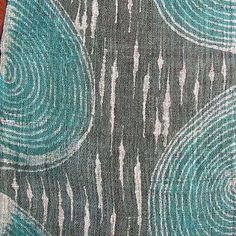 green and blue background with white batiked circular designs on hemp fabric