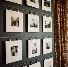 would put it directly on the wall, but nice way to display photos. (curtain hangers)