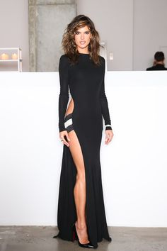 Alessandra Ambrosio, knock me down with a feather...Alessandra is drop dead gorgeous in this black floor length gown at the Acrias holiday dinner.