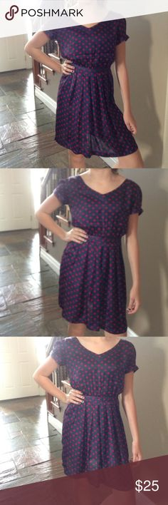 Polka Dot Dress Silky navy blue dress with red polka dots. One shoulder seem has a flaw, but you can't tell and it would be an easy fix for someone who can sew. Forever 21 Dresses