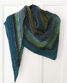 This shawl uses only two balls of Noro Kureyon and one ball of Noro Retro or Silk Garden Solo and works up quickly on larger needles using a simple slip-stitch pattern.