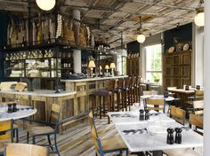 The modern rustic decor features a bar made from reclaimed wood, Pizza East Portobello