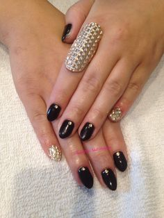 Nicole's black and gold almond nails