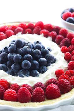 Mixed Berry Tart - An easy summertime tart with almond filling, mixed berries and whipped cream!
