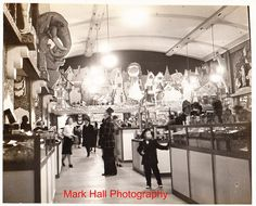 """""""J.L. HUDSON"""" main floor in 1909!  (check out the taxidermied Elelphant on the wall)    (pin via~Hudson's detroit by Detroitmi97 Aka Mark The kid, via Flickr)"""