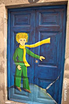 The Littlest Prince Door in Painted door in Zona Velha (Old Town), Funchal, Madeira, Portugal - photo by Catia Matias, via umafotografiaumahistoria blog  ...artist not listed...