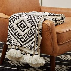Amazon.com: Rivet High Contrast Black and White Global Geometric 100% Cotton Throw Blanket: Home & Kitchen Southwestern Throws, Boho Throw Blanket, Throw Blankets, Beach Blanket, White Throws, Black And White Pillows, Geometric Throws, Geometric Patterns, African Mud Cloth