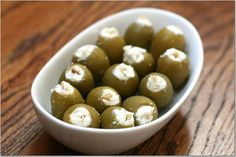 Llarge green Spanish olives, stuffed with an almond sliver ensconced in feta cheese. After stuffing, marinate them for a couple days in their original brine,  spiked with crushed garlic cloves and black peppercorns to boost the flavor.