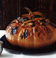 this recipe is overly complicated, but you can get the fun out of it by making your favorite vegetable stew and then adding it to a pumpkin. roast 'til slightly blackened. my mom makes beef stew and then serves it from the pumpkin at the table with a big scoop of the cooked squash itself.