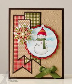 adorable snowman on a handmade card ...  kraft with muted red and green ... layered die cut snowflake ... banners of printed paper ... background with embossing folder texture ...