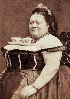 woman balancing 2 tea cups on her breasts