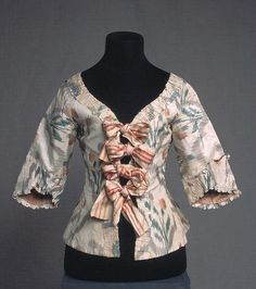 Ikat dyed silk jacket. Lined with white linen. Tied with silk ribbons. 18th century. Kulturen, Lund, Sweden. carl.kulturen.com...