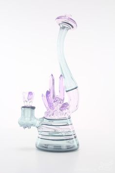 A cluster of Cold-Cut crystals! A stunning pipe from Northern Waters Glass, beautifully worked with Purple Rain glass. A cluster of cold-cut purple crystals ado