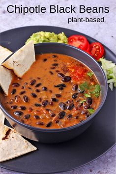Somewhere between chili and curry come chipotle black beans. Insanely easy, 30-minutes, and insanely delicious. Just spice enough, this is a perfect recipe for a weeknight family meal. #anothermusicinadifferentkitchen #homemadevegan #blackbeans #plantbased Black Bean Plant, Chili Recipes, Vegan Recipes, Chipotle Black Beans, Mild Salsa, Small Tomatoes, Vegan Chili, Curry Dishes, Cooking Black Beans