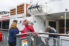 Disable woman boarding on cruise vessel along the Thames. London