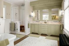 A marble vanity top and backsplash evoke an old-fashioned washstand, complete with wall-mounted faucets in this master bath redo.