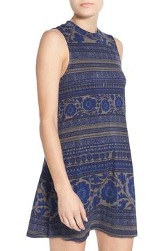 An easy breezy number to add to the fall collection. Find this cute twilight blue high neck shift dress at the NSale.