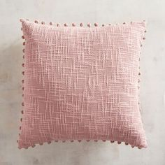 b9e8a5d11abc Surrounded by poms, our pink pillow adds texture and a happy accent  wherever it goes