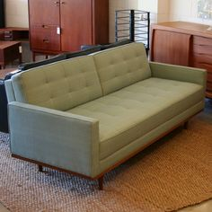 We had this couch, but ours was lime green velvet, covered in plastic of course!