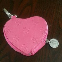 """FINAL DROP!! Ed Hardy pink heart coin purse Embossed with EH, silver tone hardware, satiny Zebra  lining,  lobster claw clip to attach to keychain or purse loop.  I don't  have a tag inside to state whether it is genuine leather or not, but I always condition my purses and accessories with mink oil and it takes that like real leather so I think it is.  The EH purse it was always with was leather. In good shape tho I used it alot. 4"""" x 3.5"""" Ed Hardy Bags Wallets"""