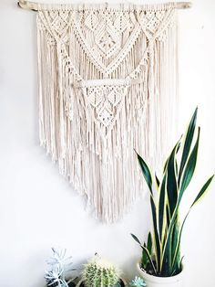 "multi-layered macrame made with 100% cotton rope. 29"" W (driftwood) 35"" L (at longest point) *ready to ship in 2-3 business days **geometric shelves by The Smal"